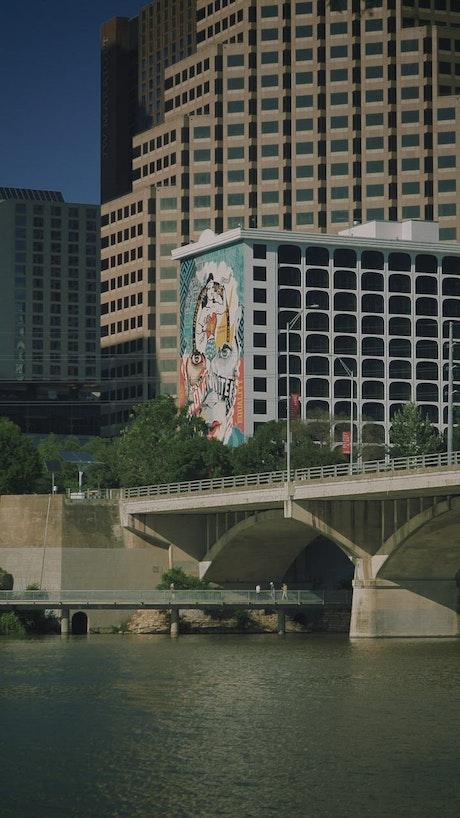 Buildings, bridge and a river of a metropolis