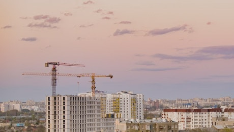 Buildings under construction at dusk, time-lapse