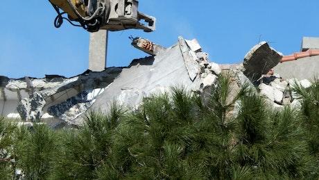 Bulldozer knocking down a construction