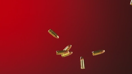 Bullets falling and bouncing in a red background