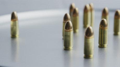 Bullets on metallic surface rotating