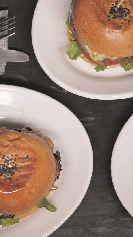 Burgers on plates on a table