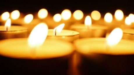 Burning candles illuminating in the dark