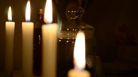 Burning candles illuminating the darkness