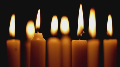 Burning candles in the dark, close up