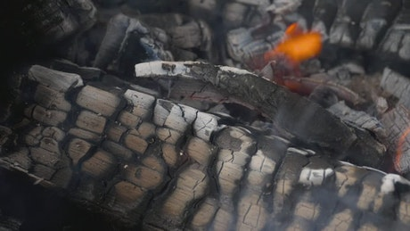 Burning charcoal and flames in slow motion