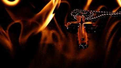 Burning crucifix necklace