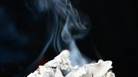 Burning paper on a black background