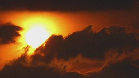 Burning Sun and dark clouds