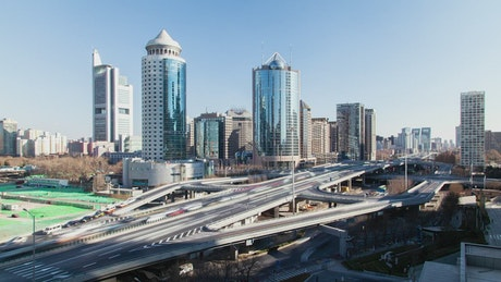 Business district and highway with traffic