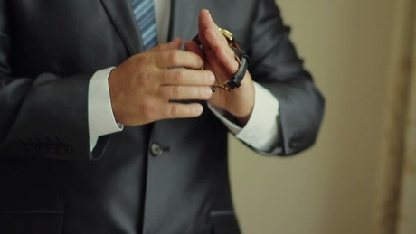 Business entrepreneur man putting on a watch