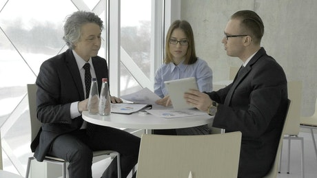 Business meeting of three people