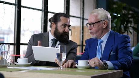 Business men talking in a restaurant