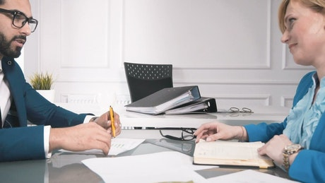 Business partners handshake over closing deal