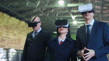 Business people using VR headsets in the warehouse