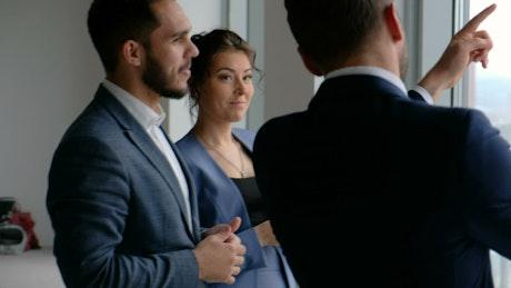 Business team talking by skyscraper window