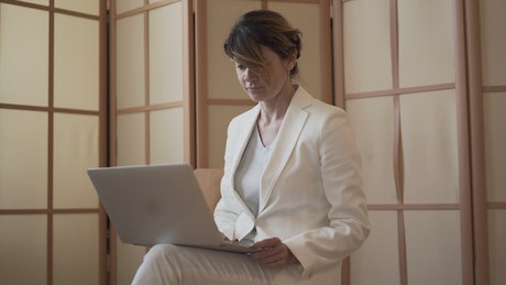 Business woman using a laptop
