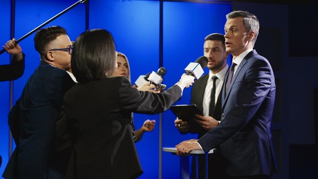Businessman cutting off interview with reporters
