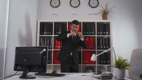 Businessman dancing in an office