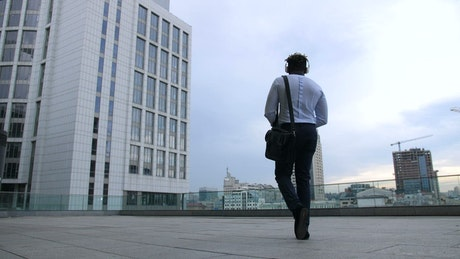 Businessman dancing while walking