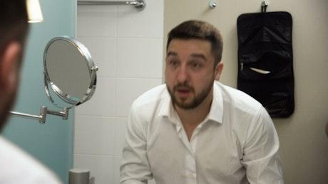 Businessman getting ready in the bathroom