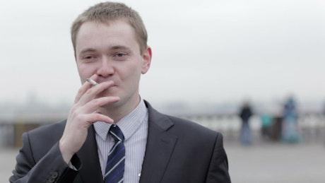 Businessman having a smoke break