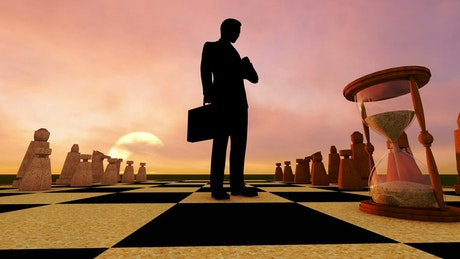 Businessman, hourglass and a giant chess