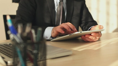 Businessman in the office using his tablet