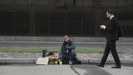 Businessman offers a job to homeless man