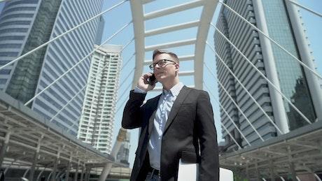 Businessman on a call on the street