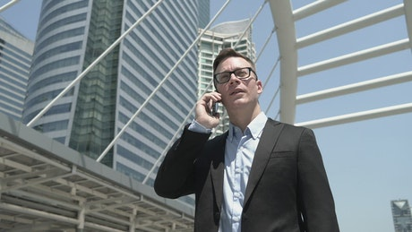 Businessman on call in the city