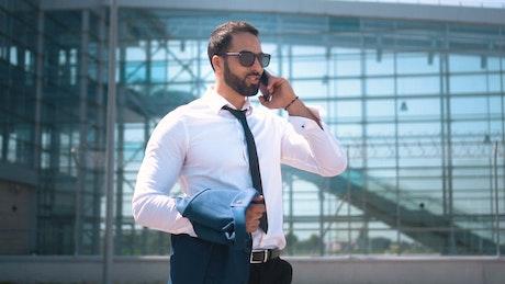 Businessman on mobile phone in Dubai street