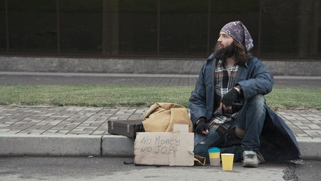 Businessman sharing food to homeless