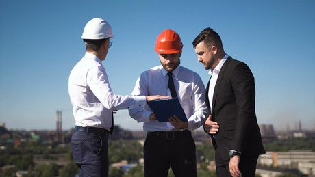 Businessman talking with engineers