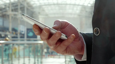 Businessman texting on a cell