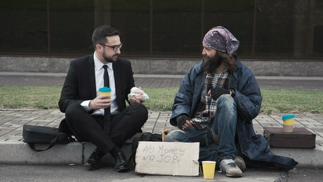Businessman with homeless on the street