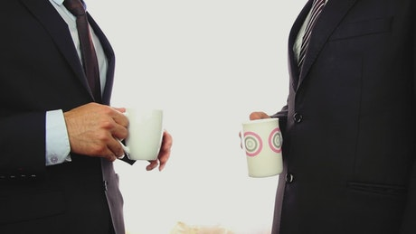 Businessmen drinking coffee while chatting