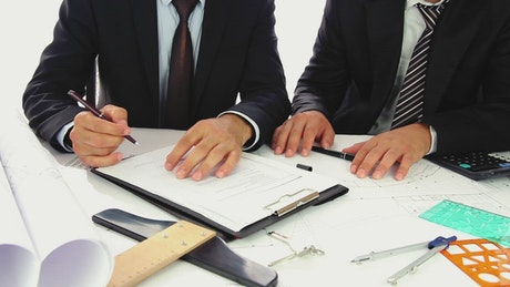 Businessmen signing a sales contract