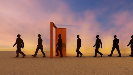 Businessmen walking in a row through a door