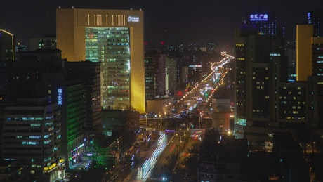 Busy road at night and buildings in Beijing