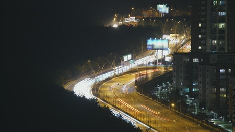 Busy road at night time lapse