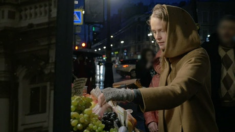 Buying from a market at night