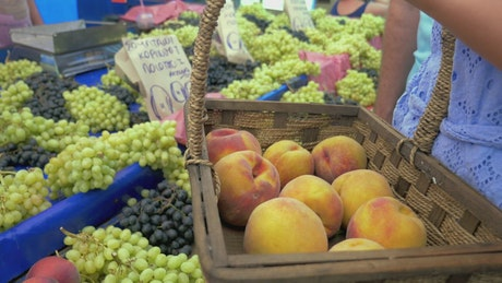 Buying grapes from a market stall