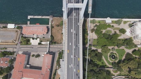 Cable bridge across a river with cars