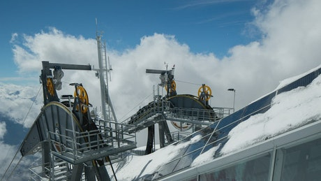 Cable car machine in the snowy mountains