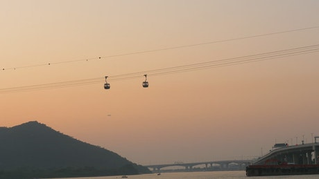 Cable cars moving in the sunset