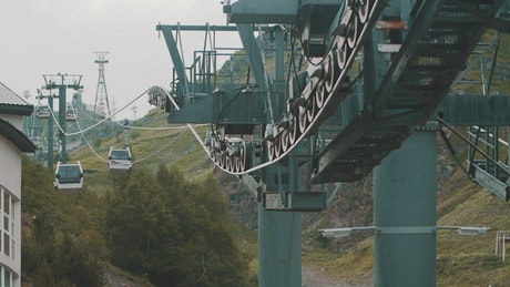 Cable Cars over green hills