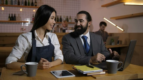 Cafe owner discussing business