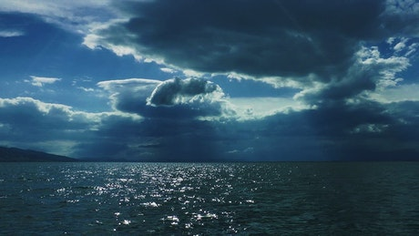 Calm sea on a cloudy day with a cloudy sky