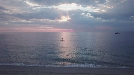 Calm sea with paddleboarder